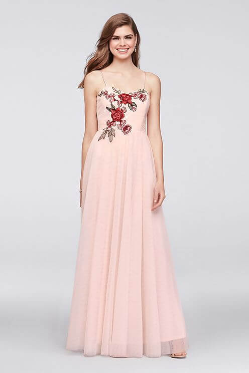 Girl in pink embroidered prom dress.