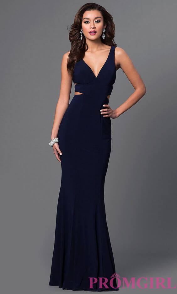 Girl in navy blue prom dress with strap detail.