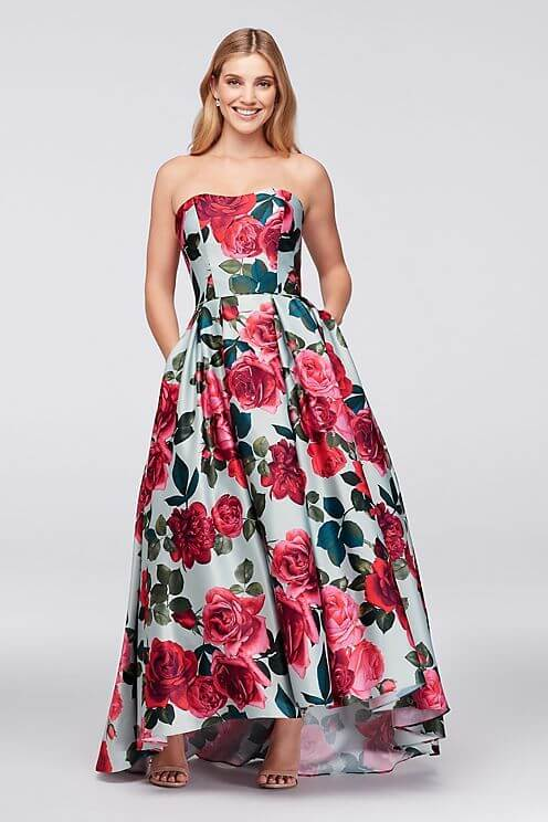 Girl in light blue and red floral strapless gown with pockets.