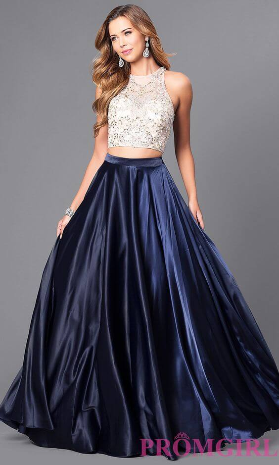 Girl in two piece prom dress with cream colored top and navy blue full skirt